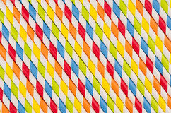 Abstract multicolored rainbow geometric striped background of beverage straw. Abstract multicolored rainbow geometric striped background beverage straw Stock Photos