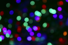 Blurred Christmas Lights On Dark Background. Blurred Image. stock photos
