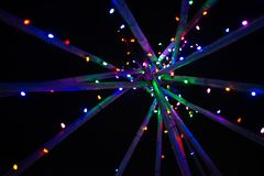 Abstract multicoloured Christmas lights on poles. Abstract multicoloured Christmas lights on wooden poles Royalty Free Stock Photography