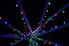 Abstract multicoloured Christmas lights on poles. Abstract multicoloured Christmas lights on wooden poles Stock Images