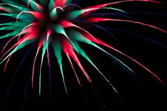 Abstract multicoloured firework burst using focus pull Royalty Free Stock Images