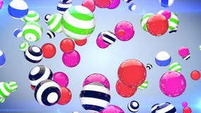 Abstract multicoloured spheres of different size flying on a blue background Stock Photography