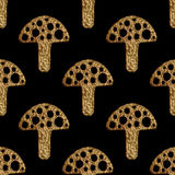Abstract mushrooms pattern. Gold hand pained seamless background. Stock Image