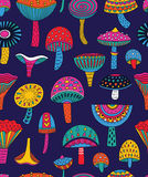 Abstract mushrooms seamless pattern in hallucinogenic colors Royalty Free Stock Image