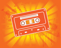 Abstract music audio cassette. On dynamic orange background Stock Image