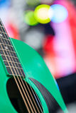Abstract music background with green guitar. Shallow depth of field Stock Photos