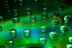 Abstract music background, water drops on CD/DVD Royalty Free Stock Images