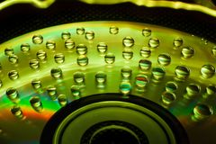 Abstract music background, water drops on CD/DVD. Abstract music background, colorful water drops on CD/DVD disc Royalty Free Stock Photos