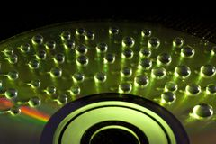 Abstract music background, water drops on CD/DVD. Abstract music background, colorful water drops on CD/DVD disc Royalty Free Stock Photography