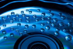 Abstract music background, water drops on CD/DVD. Abstract music background, colorful water drops on CD/DVD disc Stock Image