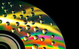 Abstract music background, water drops on CD/DVD. Abstract music background, colorful water drops on CD/DVD disc Stock Photos