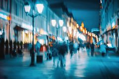 Free Abstract Narrow Pedestrian Street. Blurred Modern City, Defocused Urban Bokeh City Lights, Silhouettes Of The Walking Royalty Free Stock Photos - 166430118