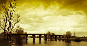 Wooden bridge and bright sky with clouds stock images