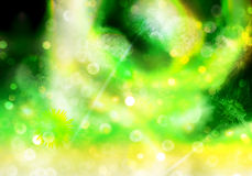 Abstract dandelion background. Abstract nature background of dandelions and round flying seed buds with soft green and yellow glows in a layered composition Stock Photo