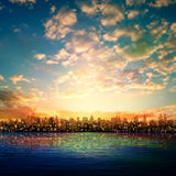 Abstract nature background with panorama of city sunrise Stock Photos