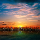 Abstract nature background with panorama of city and sunset Stock Photography