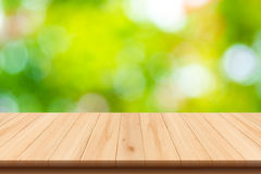 Abstract nature blurred background and wooden floor Stock Image