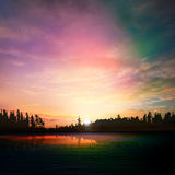 Abstract nature dark background with forest lake sunset and clou Royalty Free Stock Image