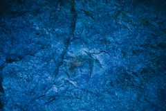 Abstract navy blue texture and background for design. Blue vintage background. Rough blue texture made with stone. Closeup view of abstract deep blue texture royalty free stock images