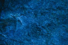 Abstract navy blue texture and background for design. Blue vintage background. Rough blue texture made with stone. Closeup view of abstract deep blue texture stock image