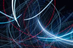 Abstract neon glowing lines in motion stock photo