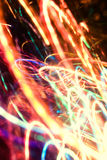 Abstract neon lights. Abstract multicolored neon lights in motion photo background effect Royalty Free Stock Photo