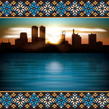 Abstract night background with silhouette of city. Abstract background with etno ornament and silhouette of city Stock Photo