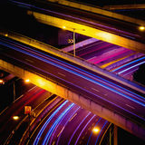 Abstract night view of highway interchange with moving cars. Hon Stock Image