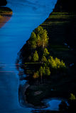 Abstract Norwegian nature. A river, a spring light, some trees in the Norway Stock Photography