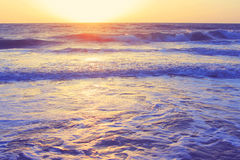 Abstract ocean seascape waves evening sunset sunrise vintage filter Stock Photos