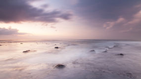 Abstract of the ocean sunrise. Soft focus effect of the wave and clouds movement at Bali beach Stock Photo