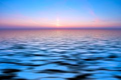 Abstract ocean and sunset back Stock Photo