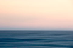 Abstract Ocean sunset. Abstract colorful ocean sunset movement stock photos