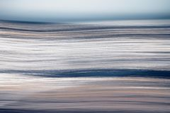 Abstract ocean waves. Abstract photo of the ocean waves, long exposure, blurs, background, blue, yellow and white lines royalty free stock photos