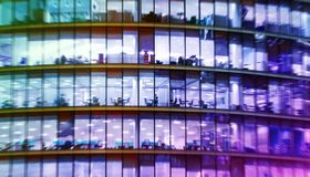 Abstract office bulding with people working Stock Image