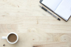 Abstract. Office desk with notebook and hot coffee top view copy space Royalty Free Stock Photography