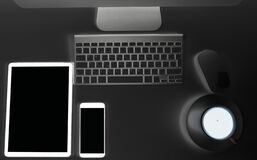 Free Abstract Office Workplace. Office Table With Tablet Computer And Smartphone. Wireless Computer Keyboard And Mouse. Cup Of Coffee Stock Photography - 182928582