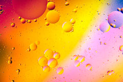 Abstract - Oil and Water on a Coloured background Royalty Free Stock Photos