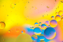 Abstract - Oil and Water on a Coloured background Stock Image