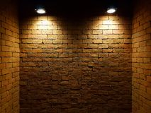Abstract old brick wall in the dark with two spotlight, warm light tone. brick wall in empty room. brick wall background stock photos