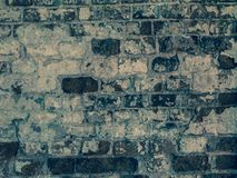 Abstract old brick wall. Threadbare surface of ancient masonry. Old brick wall of ancient building. Useful as abstract background Stock Photo