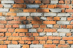 Abstract old damaged brick wall with cracks of a textured background with space for text. Stock Image