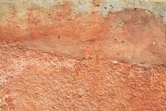 Abstract old terracotta plastered red wall texture background.  Stock Photo