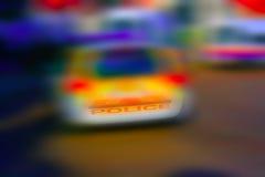 Abstract onduidelijk beeld als achtergrond van een politiewagen Royalty-vrije Stock Fotografie