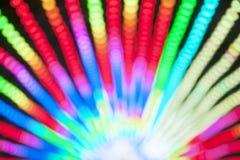 Abstract onduidelijk beeld bokeh van kleurrijke lichten binnen pretparktunnel bij nacht Stock Foto's