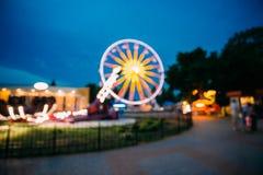 Abstract Onduidelijk beeldbeeld van Verlicht Ferris Wheel In Amusement Park Royalty-vrije Stock Fotografie