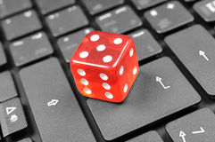 Abstract online gamble. Red dice on computer keyboard Royalty Free Stock Photography