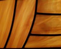 abstract ontwerp in gebrandschilderd glas in geel en bruin Stock Afbeeldingen
