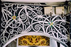 Abstract Orang Ulu motifs. Orang Ulu motifs is very much everywhere now. Here are two examples which can be found at Kuching old shoplots along the Kuching Royalty Free Stock Images