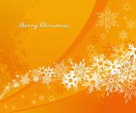 Abstract orange background with snowflakes Royalty Free Stock Photography